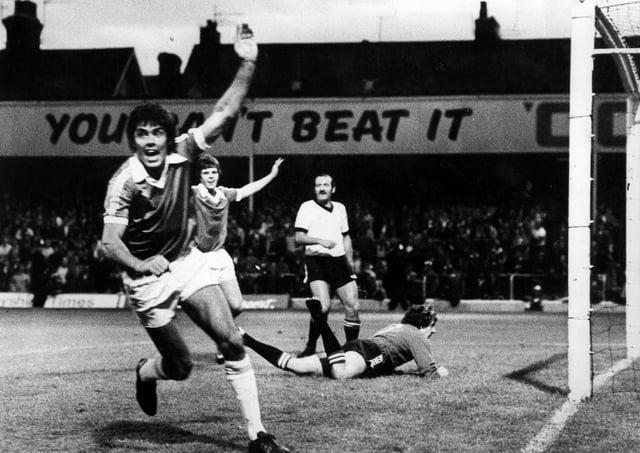 Ernie Moss celebrates a goal.