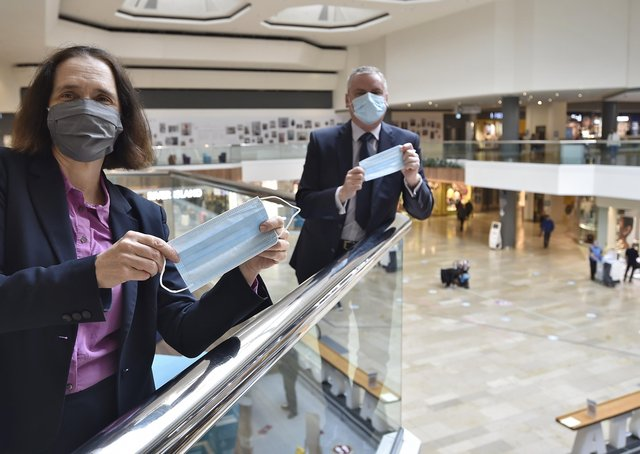 Mark Broadhead, Queensgate Centre manager, with Dr Liz Robin, the former Cambs and Peterborough CC  Director of Public Health, highlighting the importance of face masks at the height of the pandemic.