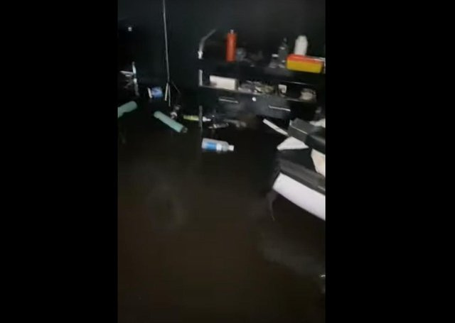 Flood waters inside Ritzy Hair Studio on Albert Place.