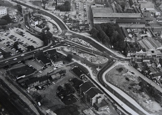 This is a great aerial shot of the city centre  which is now often referred to as Queensgate roundabout. You can see the top of Cowgate, the old Perkins factory and Crescent Bridge. Work is underway on Bourges Boulevard.