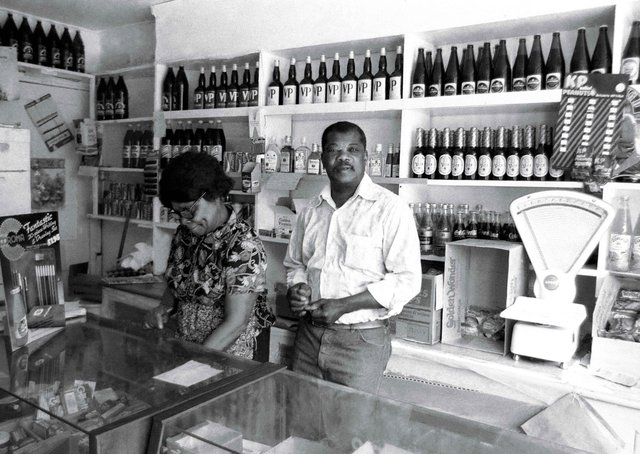 Do you recognise this Peterborough shop pictured in the 80s or the people behind the counter?
